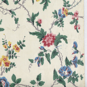 White cotton, printed by roller, small scale all-over design or roses, morning glories, etc. in reds, blues, yellow, green (blue and yellow, now turned blue), brown for stems and picotage. Glazed; selvages present.