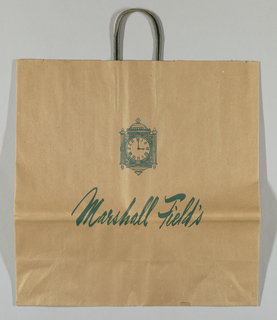 Store clock design, with time set at 3:00. Natural brown paper with design, including store name in script, in green.
