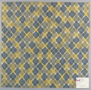 Diamonds with rounded corners overlapping each other in rows. Printed in grey/blue and tans on white. Serged on all sides.
