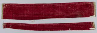 Narrow widths of upatterned red velvet.