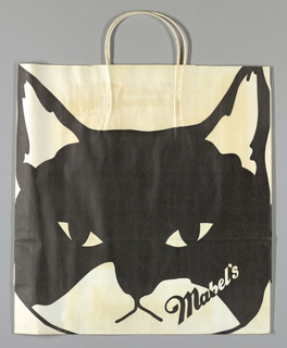 Black and white design of cat face, with store name diagonally across bottom right corner. Large format.