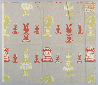 Printed plain weave in grey with a pattern of oversized chess pieces in crimson, yellow-green and white. Number 913622.