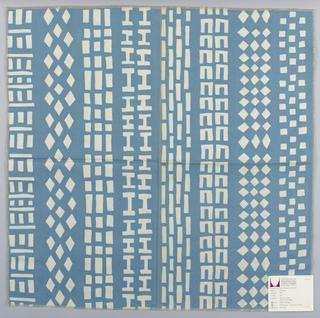"Turquoise plain weave printed with white in a geometric ""tire tread"" pattern. Printed pattern forms vertical bands. Number 973."