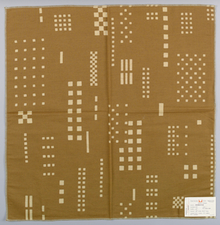 Tan plain weave with a pattern of checkerboards, squares and rectangles created by a discharge process. (Number 493, raw umber dark).