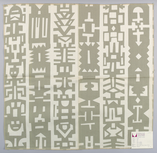 White plain weave printed with a geometric pattern in grey-brown. Printed pattern forms vertical bands. Number 990.