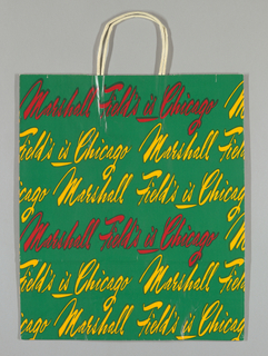 """Marshall Field's is Chicago"" text in red and gold script on medium dark green background."