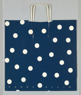 White polka dots on dark blue background. Recto: Perry Ellis across lower edge in white type. Verso: Marshall Field's [in customary script] /Distinction in Design Award, 1985, also in white.