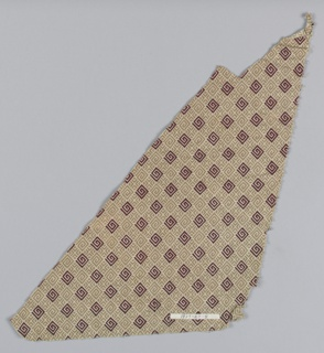 Fragment with a geometric pattern of frets and crosses in alternate rows in two shades of brown.