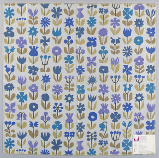 White plain weave printed with an abstract flower pattern in dark brown, brown, tan, dark blue, blue and violet. Flower pattern forms vertical bands. Number 1006.