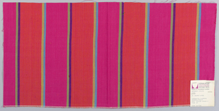 Plain weave with wide vertical stripes of magenta and orange with pairs of narrow stripes in turquoise and yellow-green and violet and green.