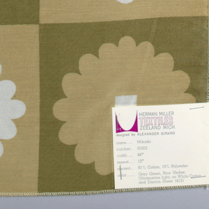 Columns and rows of stylized flowers with square center. Printed in tan, brown and gold color on white.