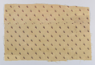 Fragment in light brown printed with a stylized leaf design in brown and red in a small allover pattern.