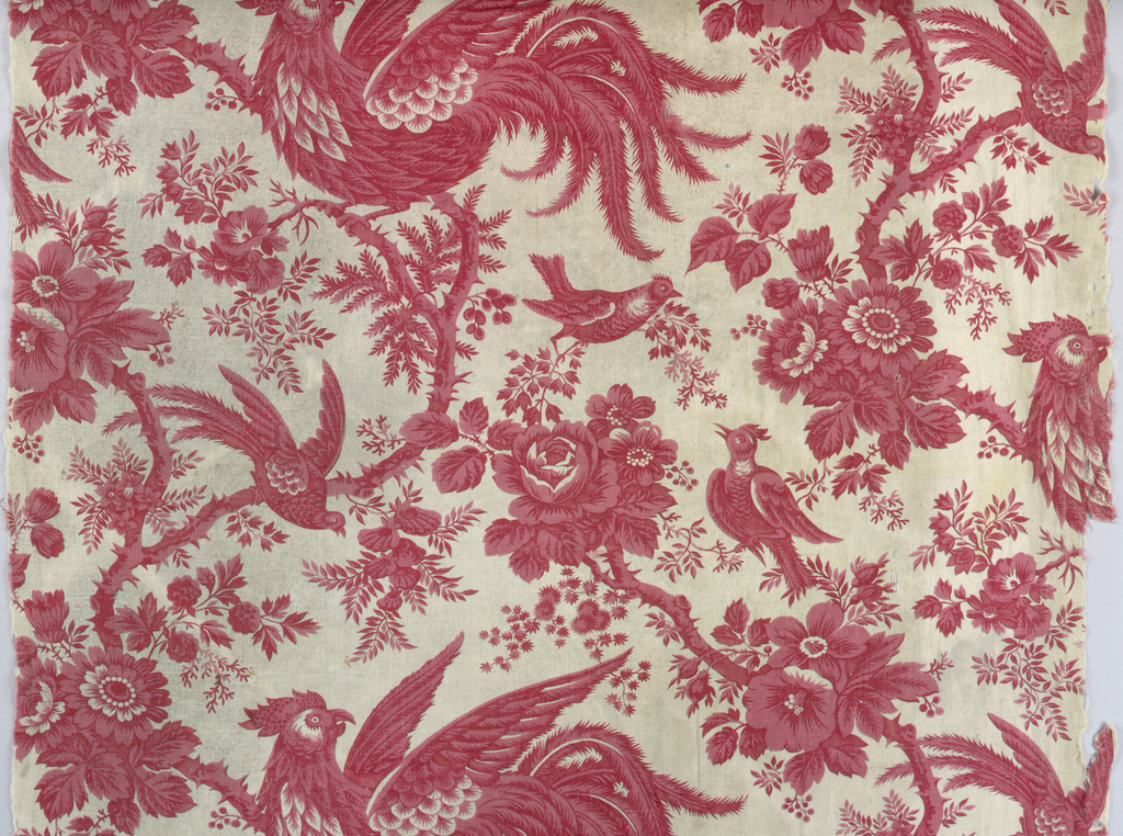 Pattern of roosters and flowering branches in two shades of red on a white ground.