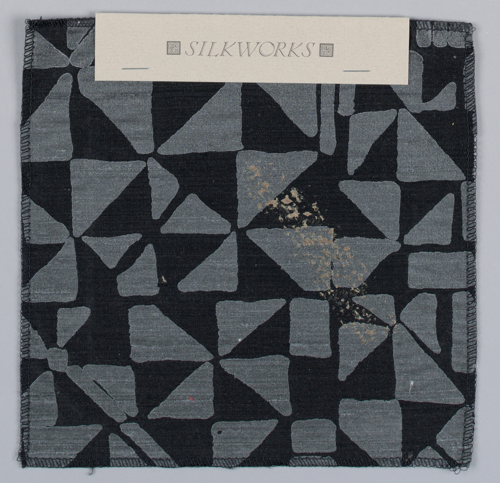 Pocketed folder containing 21 samples of fabric.