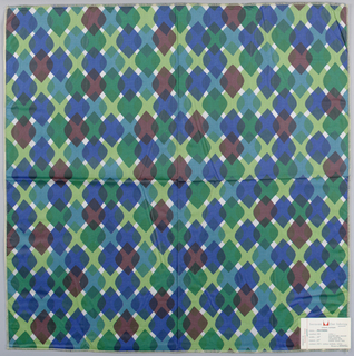 Diamonds with rounded side corners overlapping each other in rows. Printed in greens, blues, purple on white. Serged on all sides.
