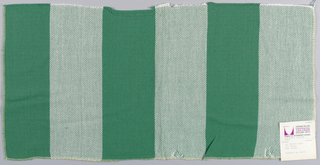 Plain weave in wide vertical stripes of dark green and white. Warp threads are dark green and white and weft threads are dark green. Slightly loose weave structure. Number 2049.