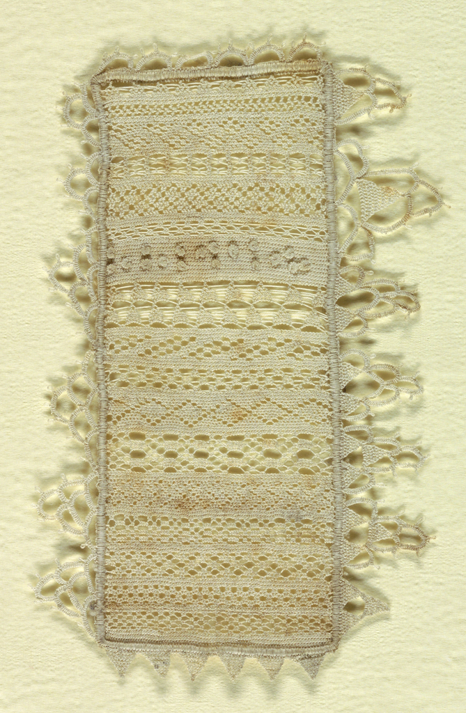 Bands of needle lace pattern with tab borders.