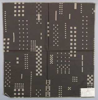 Brown-black plain weave with a pattern of checkerboards, squares and rectangles created by a discharge process.