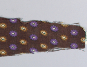 Fragment showing small purple and brown flowers with white centers on a dark brown ground.