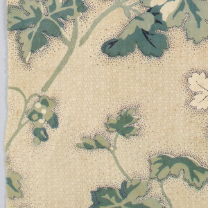 Ivy pattern in green on tan background with stippling. Glaze about worn off. Printed from engraved roller.