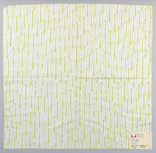 White plain weave printed with an abstract leaf pattern in light green.