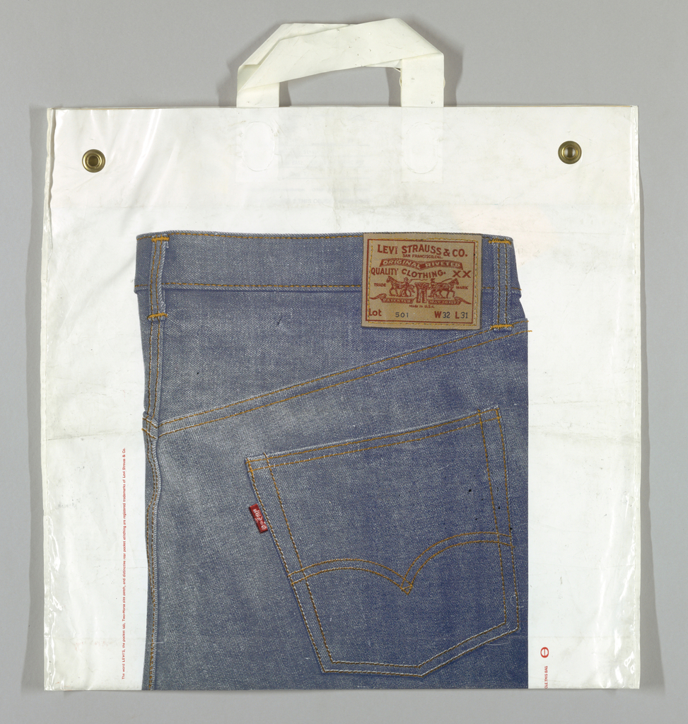 Photoreproduction of jeans and Levi Strauss leather label on white background.