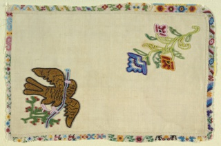 Rectangle of white cotton with patterned beadwork edge on all sides. In the field, a flower and a Mexican eagle with a snake on a cactus embroidered in multicolored beads.