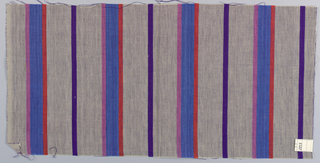 Plain weave in vertical stripes of beige and blue with narrow stripes of violet, pink and orange.