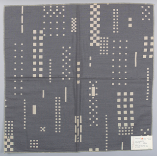 Blue-grey plain weave with a pattern of checkerboards, squares and rectangles created by a discharge process. Number 490.