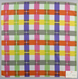 Interrupted stripes in vertical and horizontal directions form a multicolored plaid. Printed in gray, purple, green, yellow, orange, and pink on white cotton batiste. Serged on all sides.
