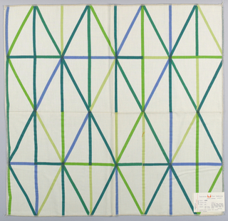 White plain weave printed with horizontal, vertical and diagonal lines in discontinuous colors of dark green, light green, yellow-green, blue and dark blue-green. Number 473.
