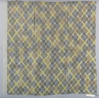 Sheer white plain weave printed with a pattern of overlapping diamonds in dark brown, brown and yellow.