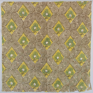 Diamond lattice decorated by a brown scroll pattern enclosing an oak leaf on a yellow background. Blue warp a right edge.