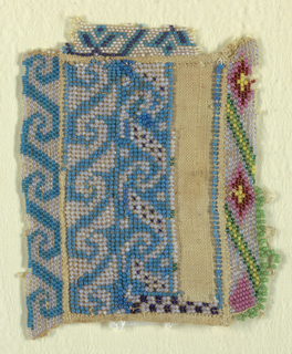 Small piece of cotton with floral and wave borders worked in blue beads, with small amounts of pink, yellow and green beads.