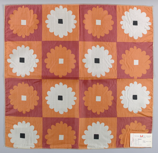 Printed plain weave in a red and orange checkerboard with an orange and white flower pattern. Red squares are printed with orange flowers with a white square in the center while the orange squares have white flowers with a black square in the center. Number 651.