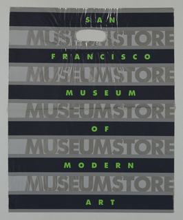 "Black and gray horizontal stripes with ""San/ Francisco/ Museum/ of/ Modern/ Art"" in green on black stripes.  ""MUSEUM STORE"" in silver repeated on each gray stripe."