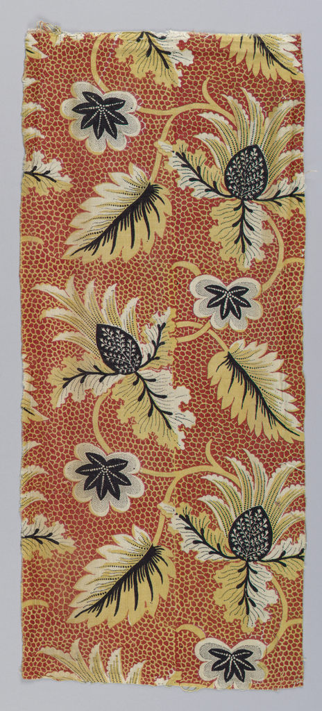 Heavy cotton printed in red, yellow and black. Background is red with an allover net design in yellow. Leaves in yellow and black with a variety of picotage.