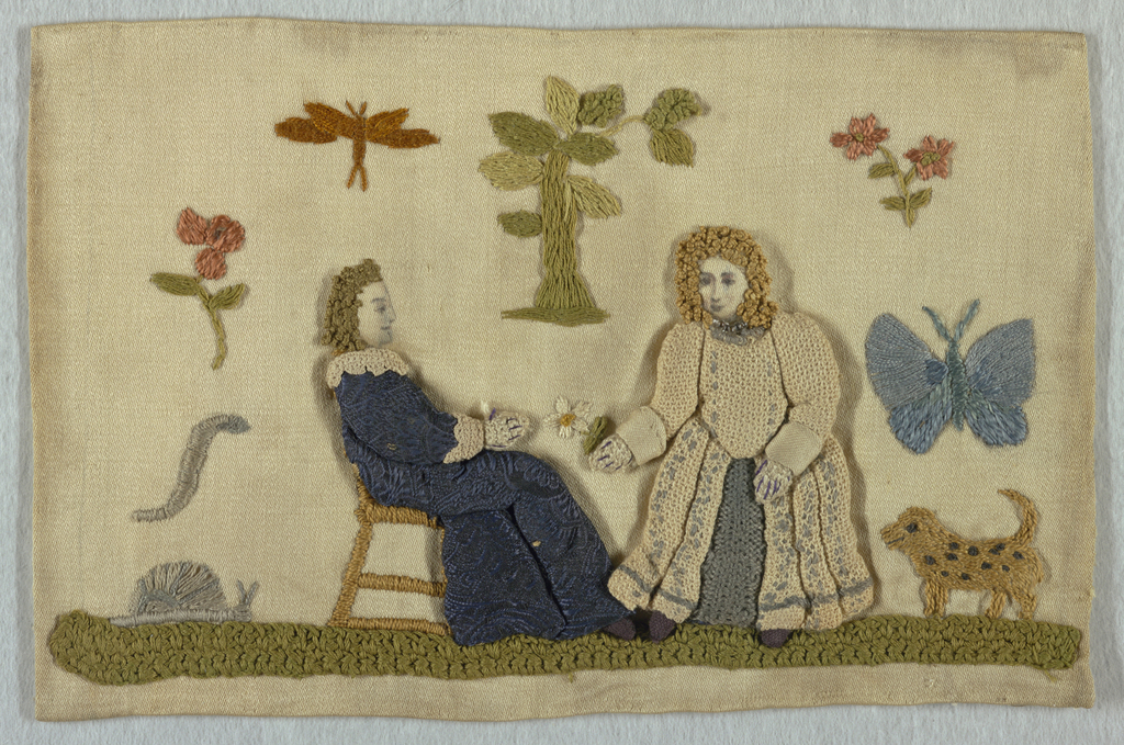 Two figures dressed in textiles (over padding) with embroidered details; embroidered dog, tree, flowers and insects. Lined with white silk.