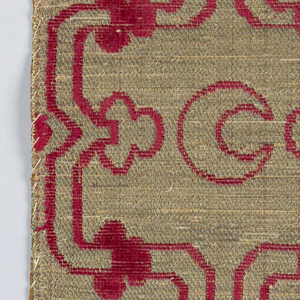 Strap motif with crescents and lotus buds in metallic and red.