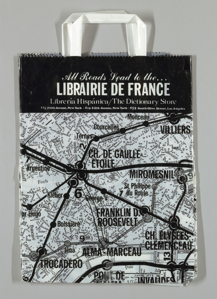 "Black and white map of Paris Metro lines converging at the Charles deGaulle/Etoile stop, superimposed on map of Paris. Black border with white text, ""All Roads Lead to the/LIBRAIRIE DE FRANCE/Liberia Hispanica/The Dictionary Store."""