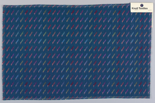 Deep blue ground with design of diagonal slashes in mixed shades of olive, purple, red, pink and blue.