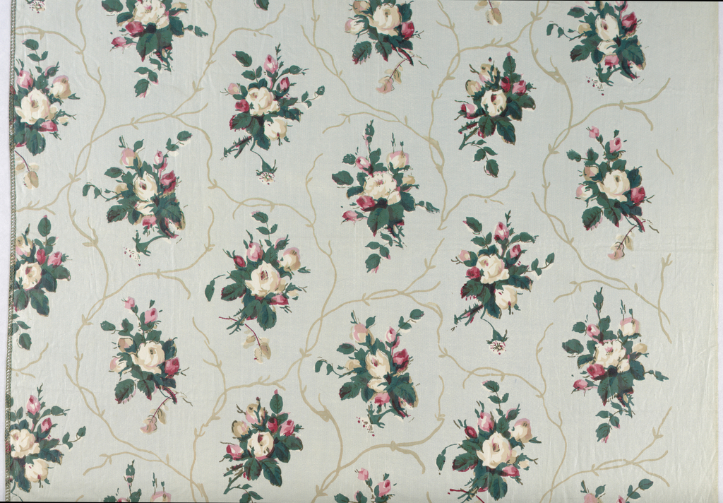 Allover design of floral sprays in red, green and tan on light blue background.