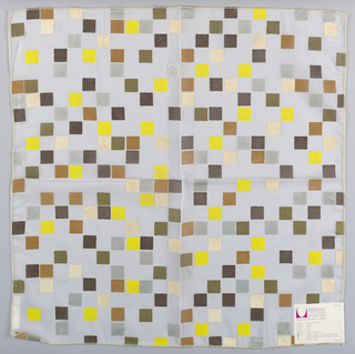 White sheer polyester plain weave printed with squares of off-white, yellow, tan, dark brown, gold and silver. Number 55402.