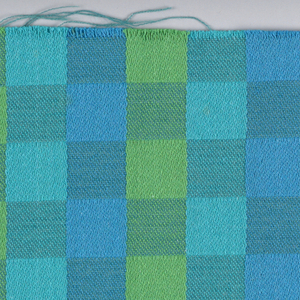 """Grid of squares in two different weave structures in """"Blue and Green"""" colorway."""
