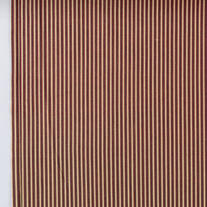 Brown and red narrow stripes on a tan ground.