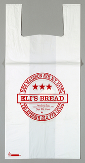 "White plastic with red text ""ELI'S BREAD"" in circle."