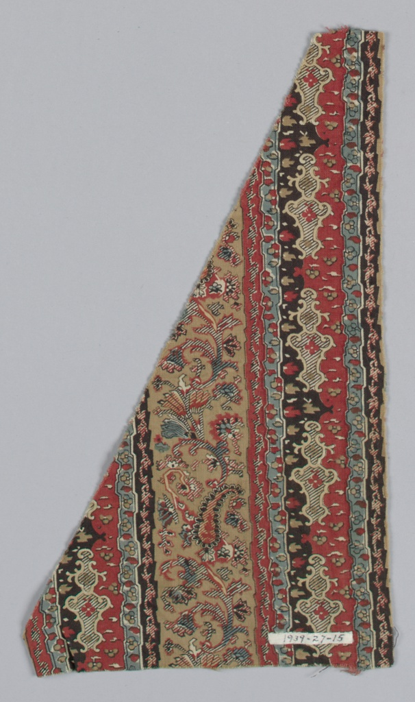 Fragment has vertical stripes of black, green, red, and brown with a stylized floral, ogival and paisley pattern.