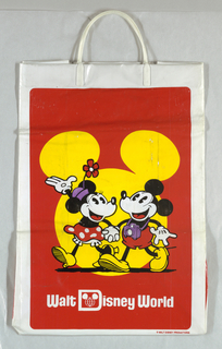 Red, purple, and yellow image of Minnie and Mickey Mouse holding hands on red background; yellow outlined figure of Mickey's head.  Walt Disney World logo in white centered at bottom.