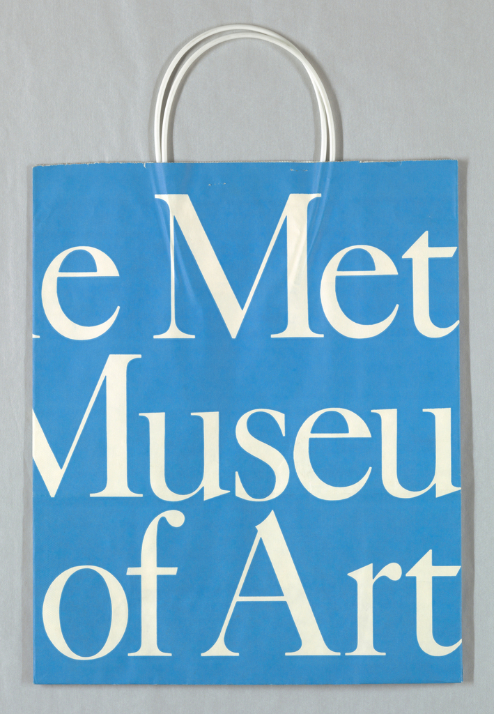 """Metropolitan Museum of Art"" in white repeated on blue background. Design continues in side panels."