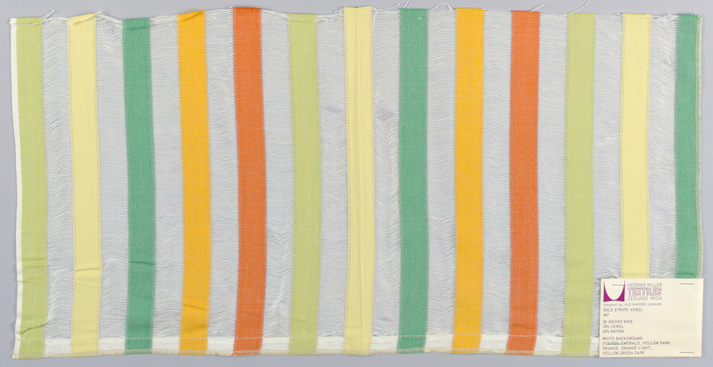 Vertical bands of plain weave in green, yellow, yellow-green, dark orange, and light orange connected by a gauze weave of long weft floats in white. Number 447.
